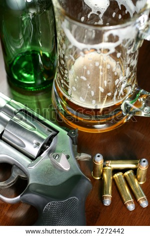 Beer and Guns don't mix. - stock photo