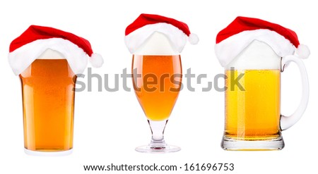 Beer and hat of Santa Claus isolated on white - stock photo