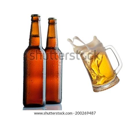 Beer background, Beer bottles and mug with beer splashas. - stock photo