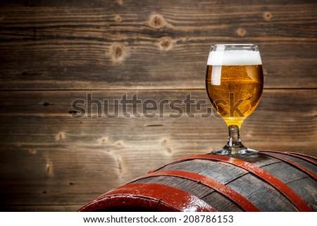 Beer barrel with beer glass - stock photo