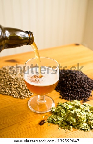 Beer being poured - stock photo