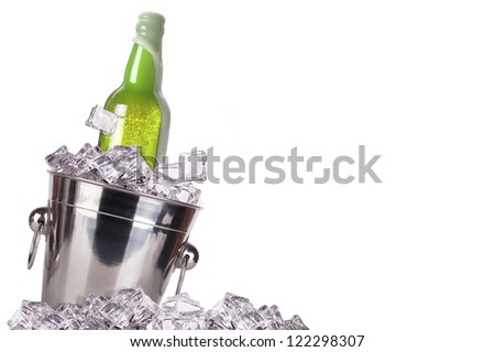 beer bottle in ice bucket isolated on a white background - stock photo