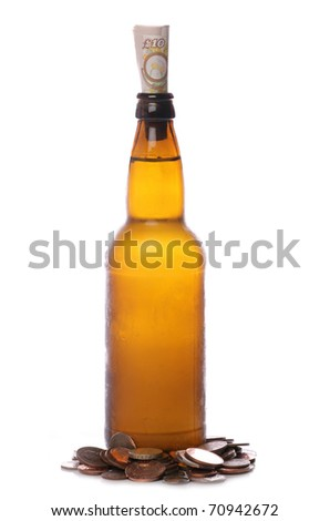 Beer bottle with sterling money studio cutout - stock photo
