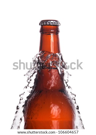 Beer bottle with water splash isolated on a white background - stock photo