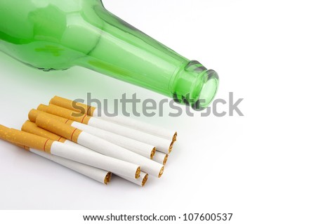 Beer bottles and cigarette - stock photo