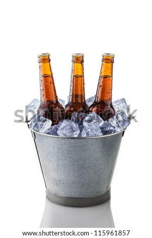 beer bottles in a bucket of ice isolated on white background - stock photo