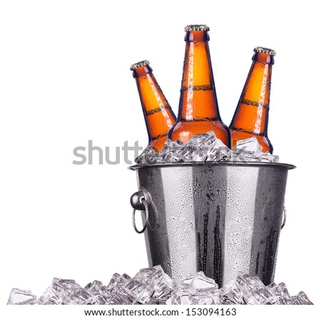Beer bottles in ice bucket isolated on white  stock photo