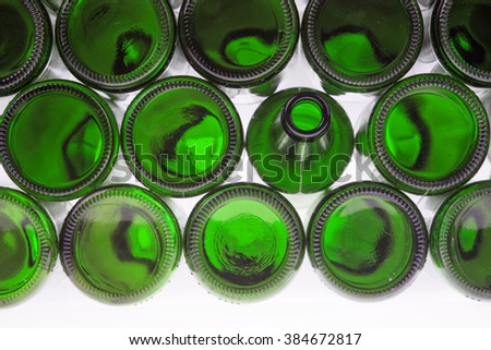 Beer bottles of green glass background, glass texture - stock photo