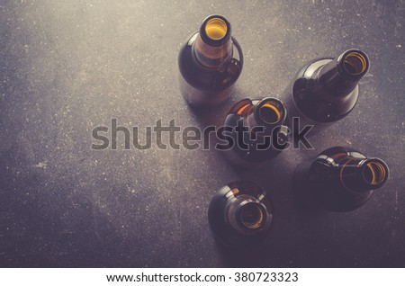 Beer bottles on dark table - stock photo
