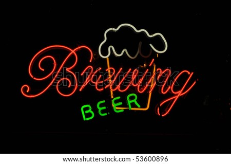 Beer Brewing Neon Light Sign with Frosty Mug - stock photo