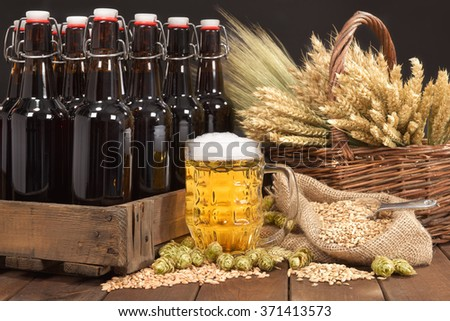 beer crate and beer glass with hops, wheat, grain, barley and malt - stock photo