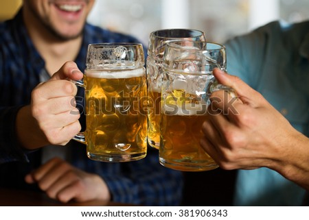 Beer fans. Cropped closeup of three men cheering with their beers - stock photo