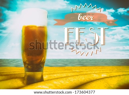 Beer fest sign with glass on beach - stock photo