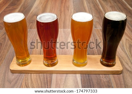 Beer Flight. Four kinds of beer  - stock photo