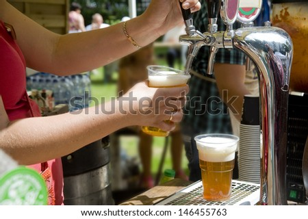 Beer flood in a glass and its sale  - stock photo