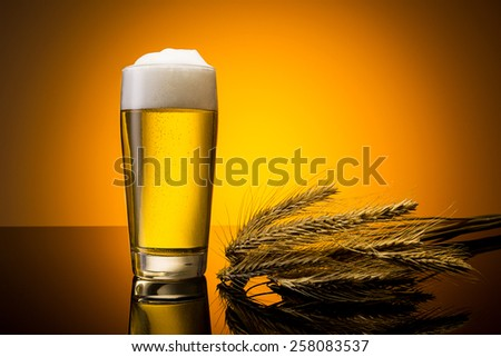 beer in a german willi cup with corn ears - stock photo