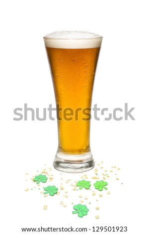 Beer In a pilsner glass with St. Patrick Day theme. Isolated against white background. - stock photo