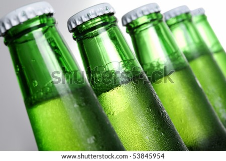 Beer in bottle on a white background - stock photo