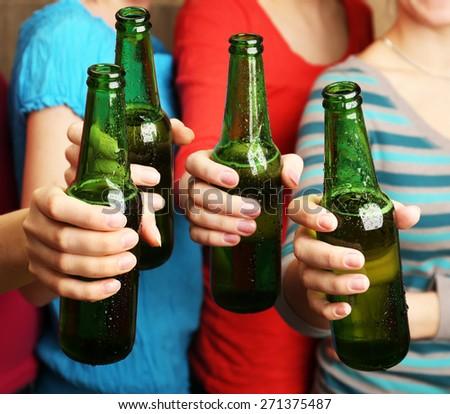 Beer in female hands, closeup - stock photo