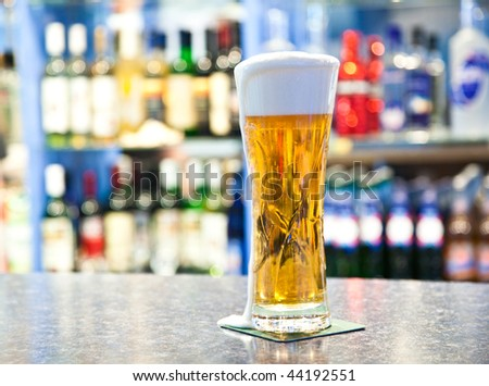 Beer in glass in a pub - stock photo