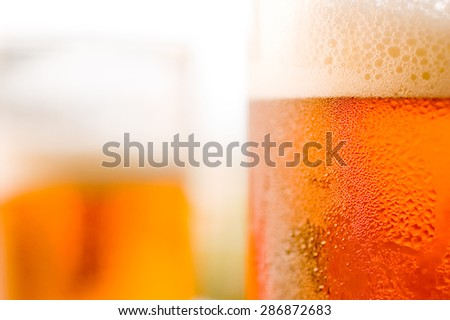 Beer in glass in detail - stock photo