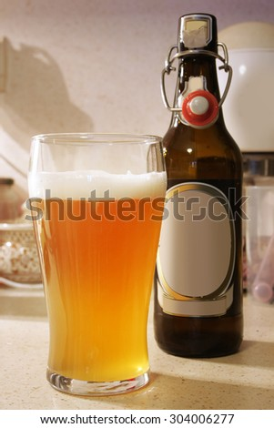 beer in glass with beer bottle with buckle - stock photo