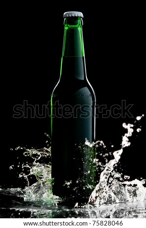 Beer in green bottle with water splash isolated on black - stock photo