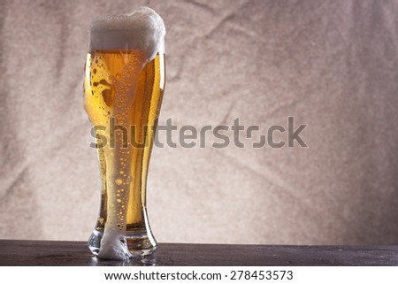 Beer into glass - stock photo