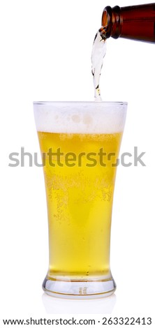 Beer into glass isolated on white background.  - stock photo