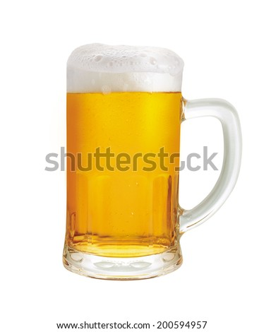 Beer mug. A mug of beer with froth and slight spill  - stock photo