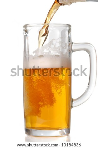 Beer mug isolated on white. Pouring beer in it. - stock photo
