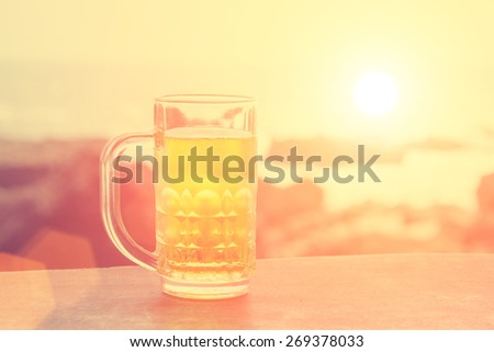 Beer mug on the background of rocks. - instagram style - stock photo