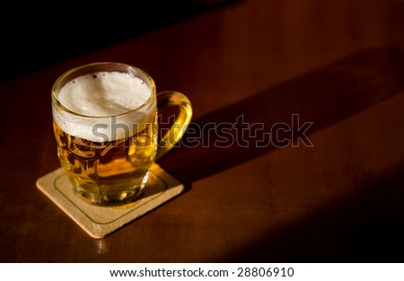 Beer mug over wood background - stock photo