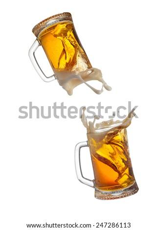 Beer mugs splashing - stock photo