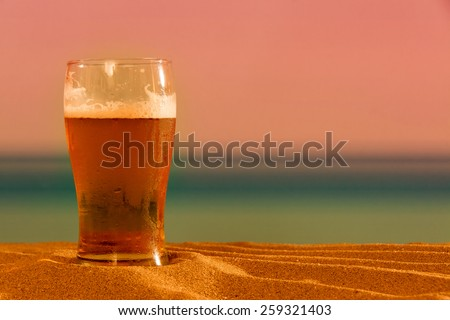 Beer on the beach - stock photo