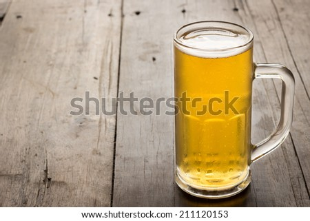 Beer on the wooden floor - stock photo