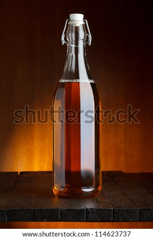 Beer or cider bottle wooden table still life - stock photo