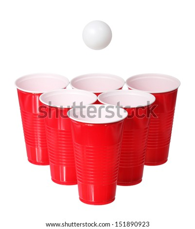 Beer pong. Red plastic cups and ping pong ball isolated on white background - stock photo