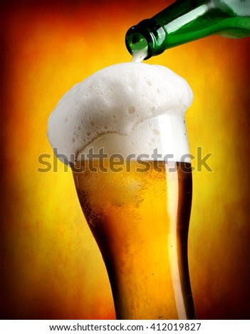 Beer pouring in tumbler - stock photo