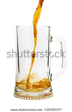 Beer pouring into glass isolated over white background - stock photo