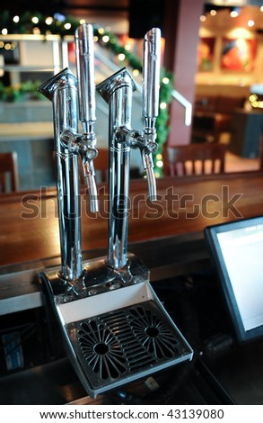 Beer pumps at the pub - stock photo