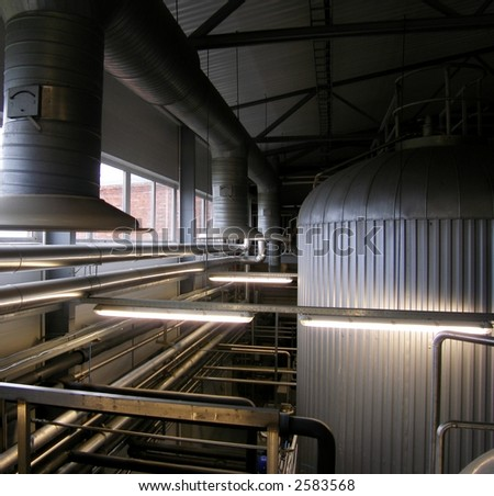 Beer storage tanks - stock photo