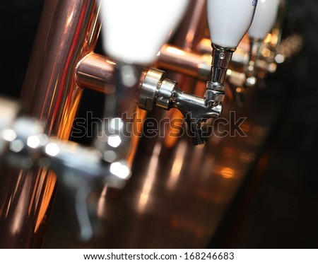 Beer tap array amber - stock photo