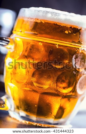 Beer. Two cold beers. Draft beer. Draft ale. Golden beer. Golden ale. Two gold beer with froth on top. Draft cold beer in glass jars in pub hotel or restaurant. Still life. - stock photo