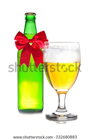 Beer with Christmas ribbon isolated on white background, shallow focus - stock photo