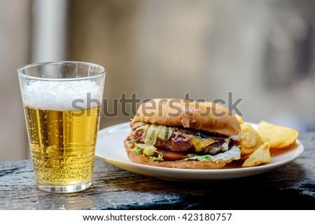 Beer With Hamburger - stock photo