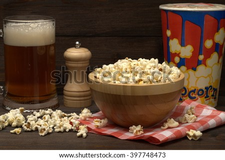 Beer with popcorn. Will decorate any holiday: birthday, party or regular dinner. - stock photo