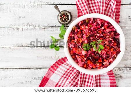 Beet salad Vinaigrette in a white bowl. Top view - stock photo