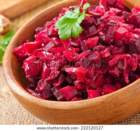 Beet salad Vinaigrette in a wooden bowl - stock photo