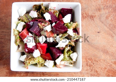 beet salad with heirloom tomato, cucumber and goat cheese - stock photo